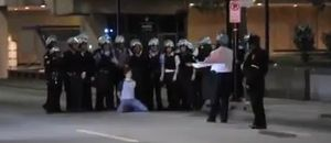 Arrestedstudentposedwithpolice